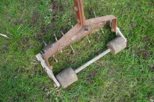 A spike aerator used for aerating a lawn.