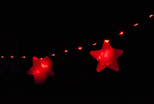 String lights with two red stars.