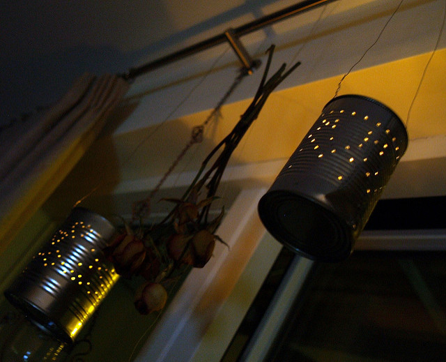Can lanterns hanging in front of a window.
